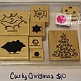 Curly Christmas stamp set, $10