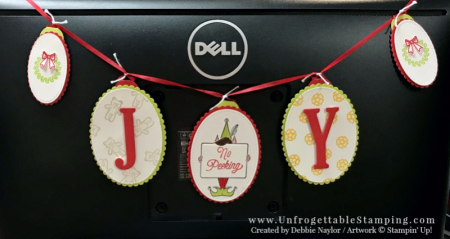 Unfrogettable Stamping | Fabulous Friday holiday banner featuring the Festive Phrases and Santa's Sleigh stamp sets, Layering Ovals & Stitched Shapes framelits and Circle Tab punch by Stampin' Up!